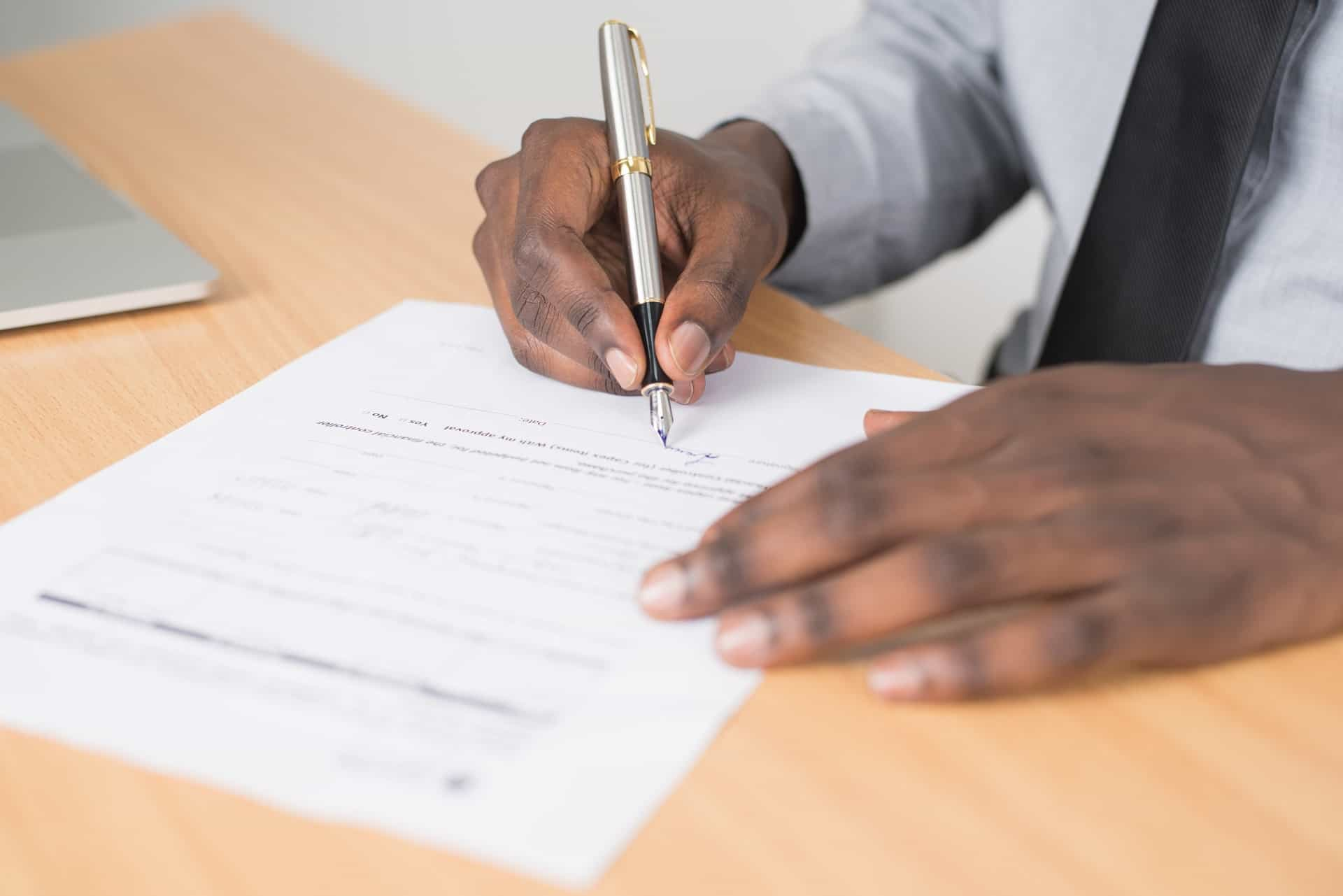 man filling out a form